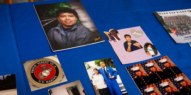 Photos of Jilmar Ramos-Gomez posted on a table at a press conference held by the American Civil Liberties Union of Michigan and Loevy & amp; Loevy Civil Law Attorneys. (Brian Hayes / The Grand Rapids Press via AP)