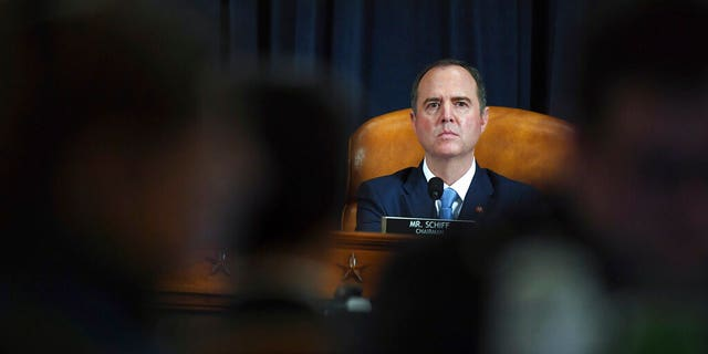House Intelligence Committee Chairman Adam Schiff, D-Calif., listen to former White House national security aide Fiona Hill and David Holmes, a U.S. diplomat in Ukraine, during testimony before the House Intelligence Committee on Capitol Hill in Washington, Thursday, Nov. 21, 2019, during a public impeachment hearing of President Donald Trump's efforts to tie U.S. aid for Ukraine to investigations of his political opponents. (Matt McCain/Pool Photo via AP)