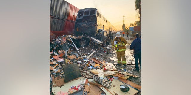 This photo provided by the Norwalk Sheriff's Station shows first responders at the scene after an RV was hit by a commuter train in Santa Fe Springs, Calif., on Friday. (Norwalk Sheriff's Station via AP)