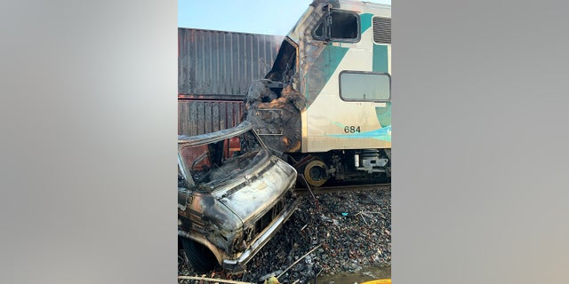 This photo provided by the Norwalk Sheriff's Station shows the scene after an RV was hit by a commuter train and burst into flames along a track in Santa Fe Springs, Calif. on Friday. Authorities say the collision occurred shortly after 5:30 a.m. Friday at an intersection in an industrial area of Santa Fe Springs. There were no immediate reports of injuries. All passengers on the Metrolink train were safely evacuated. (Norwalk Sheriff's Station via AP)
