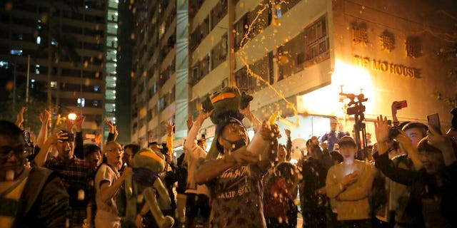 Pro-democracy supporters celebrating after pro-Beijing politician Junius Ho lost his election in Hong Kong, early Monday. (AP Photo/Kin Cheung)