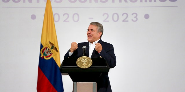 Colombia's President Ivan Duque talks during a meeting with mayors and governors in Bogota, Colombia, Sunday, Nov. 24, 2019. Duque called for a national dialogue in an attempt to quell protests decrying a range of social and economic woes. (AP Photo/Ivan Valencia)