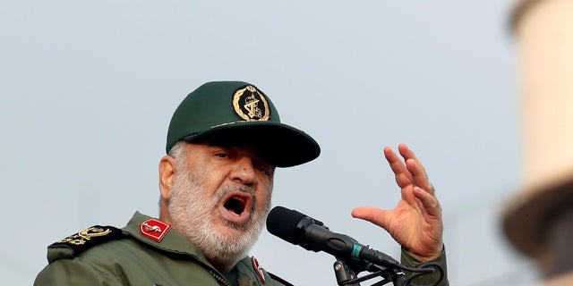 Chief of Iran's Revolutionary Guard Gen. Hossein Salami speaks at a pro-government rally denouncing last week's violent protests over a fuel price hike in Tehran on Monday. (AP Photo/Ebrahim Noroozi)