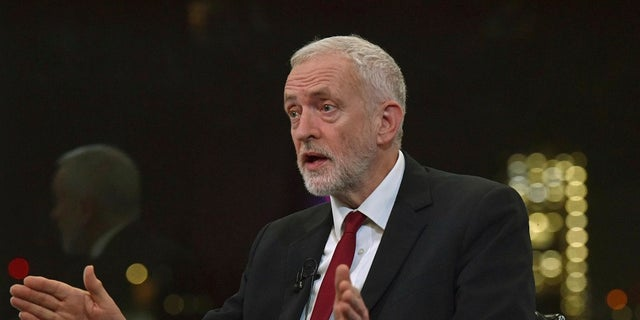 Britain's Labour Party leader Jeremy Corbyn speaks during a BBC interview in London on Tuesday. Corbyn and his party have been deeply tarnished by anti-Semitism accusations, as the UK prepares to go to the polls in a General Election on Dec. 12. (Jeff Overs/BBC via AP)