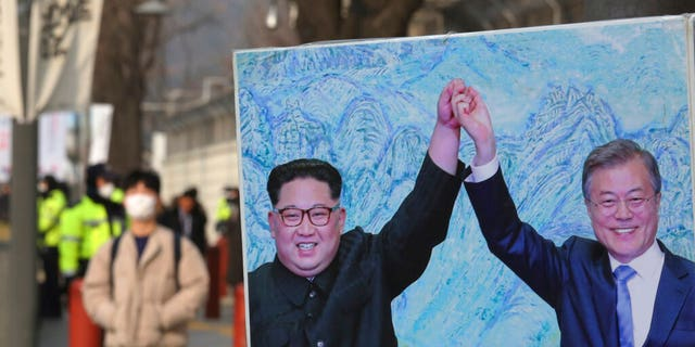 North Korean leader Kim Jong Un and South Korean President Moon Jae-in, right,in a banner in Seoul.