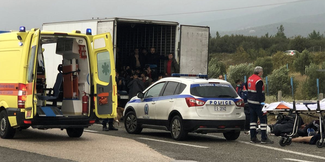 Migrants are seen inside a refrigerated truck found by police, after a check at a motorway near Xanthi, Greece, November 4, 2019.