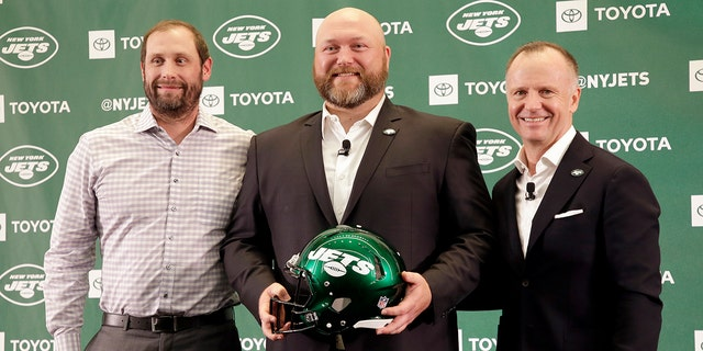 FILE - In this June 11, 2019, file photo, New New York Jets general manager Joe Douglas, center, poses for a picture with head coach Adam Gase, left, and Jets chairman and CEO Christopher Johnson during a news conference at the team's NFL football training facility in Florham Park, N.J. (AP Photo/Seth Wenig, File)