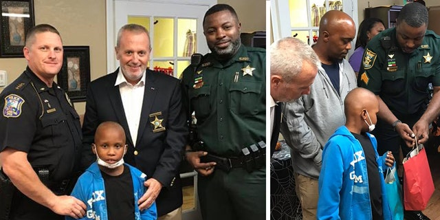 Law enforcement officers welcomed the boy home from treatment and presented him with the Disney World trip.