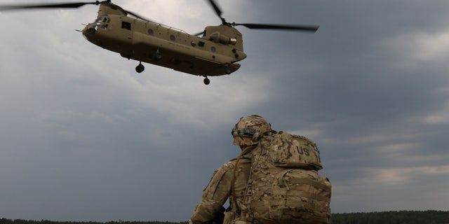Capt. Gary Gorrel assigned to the 143rd Airborne Infantry Regiment from Texas, waits for his chinook to arrive, to conduct an air insertion exercise June, 10 2018, with members of the Israeli Defense Forces, the Italian Armed Forces and the Polish Army for exercise Swift Response. Exercise Swift Response 18 was a U.S. Army Europe-led multinational exercise held in Latvia, Lithuania and Poland - file photo.
