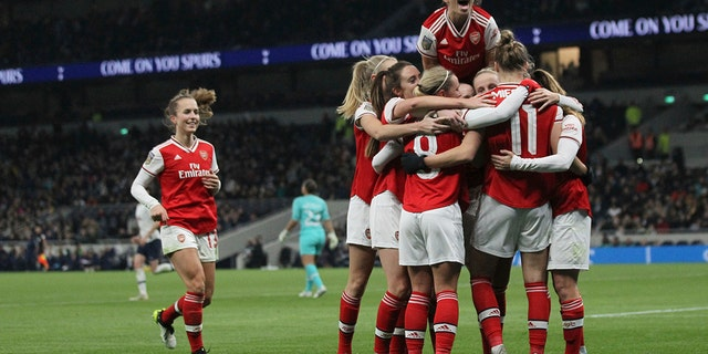 Arsenal celebrate after Vivanne Miedema scores her sides second goal of the match against Tottenham Hotspur during their Women's Super League soccer match at the Tottenham Hotspur Stadium in London, Sunday Nov. 17, 2019. The match drew a record crowd of 38,262 for the competition on Sunday when Arsenal claimed a 2-0 victory at Tottenham. (Zac Goodwin/PA via AP)