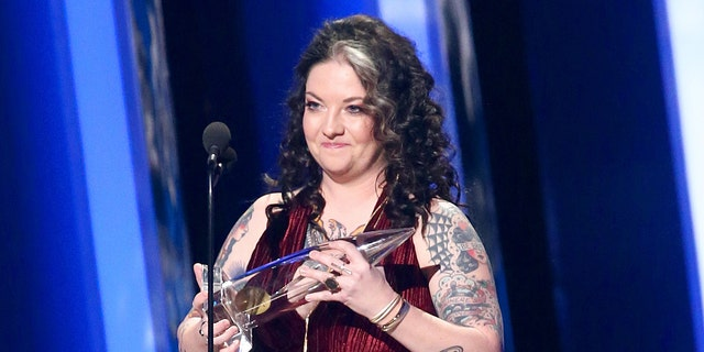 Ashley McBryde accepts an award onstage during the 53rd annual CMA Awards at the Bridgestone Arena on November 13, 2019 in Nashville, Tennessee. (Photo by Terry Wyatt/Getty Images,)