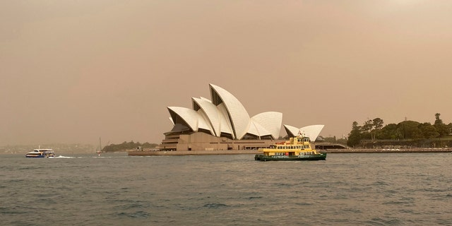 Sydney Opera House is backdropped by haze from wildfires near the city, in Sydney, Australia, Tuesday Nov. 12, 2019.