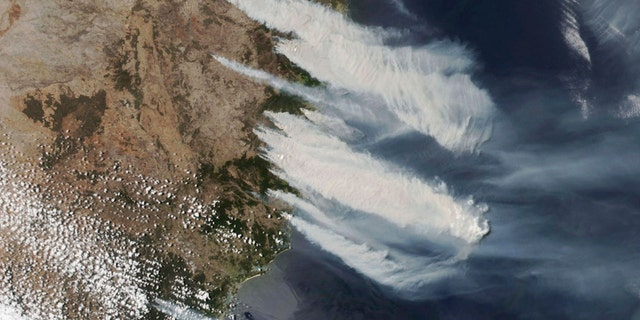 This Nov. 8, 2019, satellite photo taken by NASA shows hot, dry and windy weather conditions as bushfires burn in the eastern part of News South Wales state.