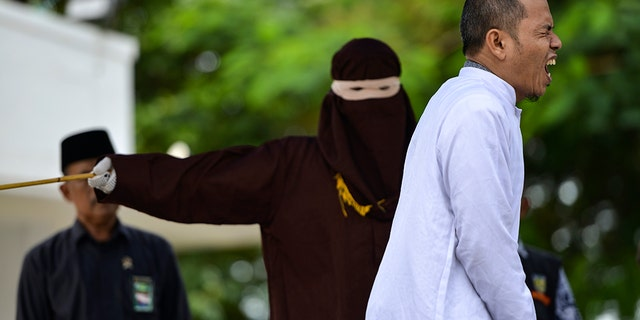 An Indonesian man working for an organization that helped draft strict religious laws ordering adulterers to be flogged was himself publically whipped on October 31 after he was caught having an affair with a married woman.
