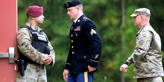 """U.S. Army Sgt. Robert Bowdrie """"Bowe"""" Bergdahl is escorted to the Ft. Bragg military courthouse following a lunch recess after pleading guilty to desertion and misbehavior before the enemy on October 16, 2017 in Fort Bragg, North Carolina. An appeals court will review his case to determine whether comments made by President Trump or others led to an unfair trial.<br> (Photo by Sara D. Davis/Getty Images)"""