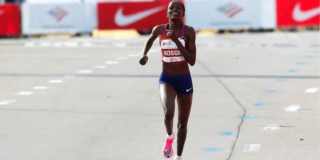 2019 Kenya's Brigid Kosgei runs to finish to win the women's marathon setting a new world record while using the Nike Vaporfly shoes.