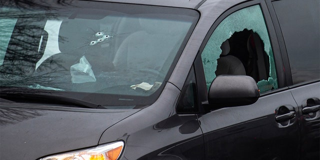 Bullet holes are seen here in the windows of a van in the parking lot of Sarah J. Anderson Elementary School in Vancouver, Wash., following a shooting on Tuesday, Nov. 26, 2019. Authorities say a man shot several people in a Vancouver, Wash., elementary school parking lot and then shot himself after a police chase.