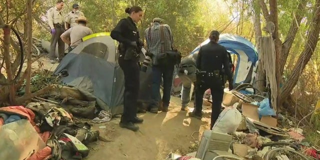 Crews work to dismantle homeless encampment in the Sepulveda Basin Wildlife Reserve on Monday.