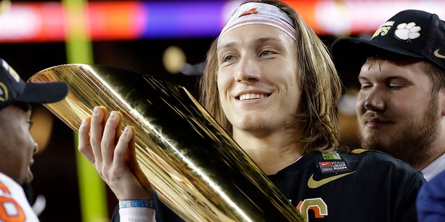 Trevor Lawrence can't jump to the NFL just yet. (AP Photo/David J. Phillip, File)