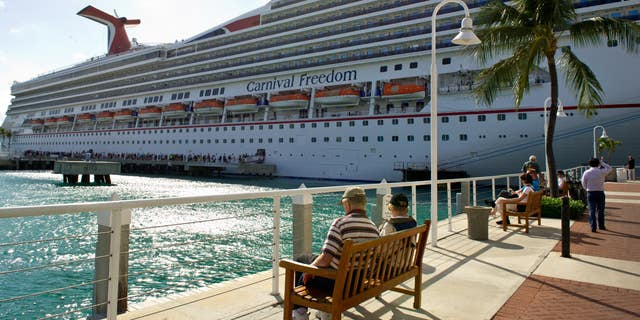 """The Carnival Freedom, seen here during a 2013 sailing, had an issue related to a malfunction with its engine turbocharger.""""That engine was quickly shut down and the smoke ceased,"""" Carnival said."""
