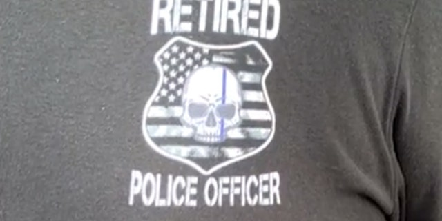 "Vincent Champion was wearing a T-shirt that read ""Retired Police Officer"" on the front, but Universal said it has a policy against allowing anyone inside with a shirt that might identify them as emergency personnel."