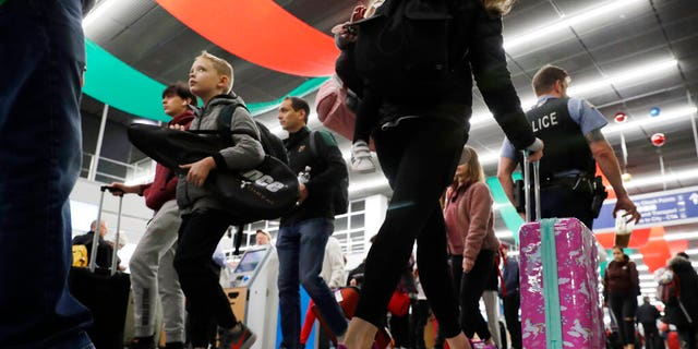 Travelers are seen passing through Chicago's O'Hare International Airport amid one of the busiest travel periods of the year.