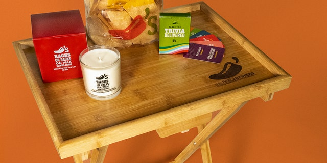 The Chili's starter container comes with a rib-scented candle, a doormat, a TV tray, a trivia diversion and a chip bag clip.