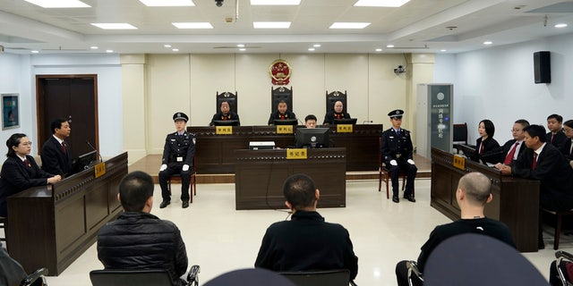 A trial continues as fentanyl drug traffickers are sentenced in court, Thursday, Nov. 7, 2019, in Xingtai, north China's Hebei Province.