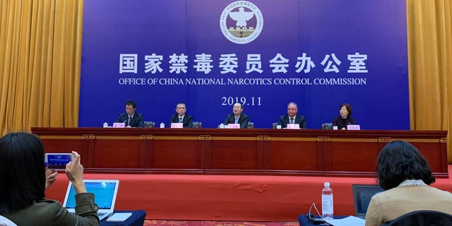 Chinese and U.S. enforcement officers hold a press conference on cracking down on fentanyl trafficking in Xingtai in northern China's Hebei province on Thursday, Nov. 7, 2019.