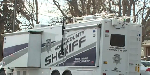 The grisly discovery drew a large emergency response to unincorporated Adams County.
