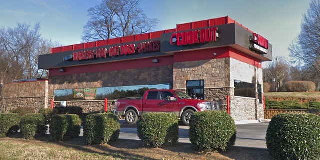 Taren Woods, a 10-year Cook Out employee and on-duty manager, claims she was dismissed after a treasurer refused service to a police officer, even though the woman followed company policy by asking another treasurer to take his order.