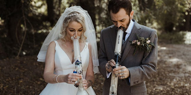 """The bride and groom celebrated their new union not with a champagne toast using personalized glasses – but with a bong rip using specially-made """"Mr"""" and """"Mrs"""" glass water pipes."""