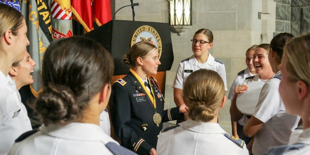 Heisler talks with members of the West Point Women's Soccer team after the award ceremony. (U.S. Army photo by Brandon O'Connor)
