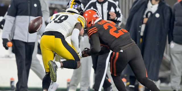 Cleveland Browns strong safety Damarious Randall (23) hits Pittsburgh Steelers wide receiver Diontae Johnson (18) during the second half of an NFL football game Thursday, Nov. 14, 2019, in Cleveland. Randall was called for unnecessary roughness and was ejected.