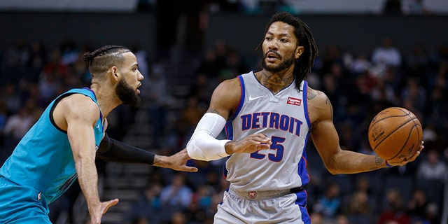 Detroit Pistons guard Derrick Rose, right, looks to pass the ball as Charlotte Hornets forward Cody Martin defends during the second half of an NBA basketball game in Charlotte, N.C., Friday, Nov. 15, 2019. Charlotte won 109-106. (AP Photo/Nell Redmond)