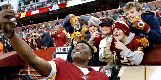 Westlake Legal Group Dwayne-Haskins-1 Washington Redskins' Dwayne Haskins takes selfie with fan, misses final snap Frank Miles fox-news/sports/nfl/washington-redskins fox-news/sports/nfl/detroit-lions fox-news/person/dwayne-haskins fox-news/odd-news fox news fnc/sports fnc article 32036f3b-811c-5269-855d-ed49ea7952cc