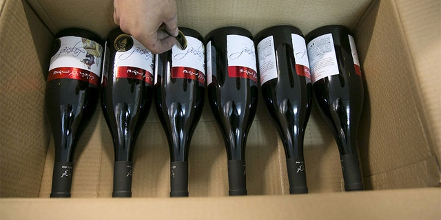 A worker places stickers on wine bottles at Shiloh Wineries, north of the West Bank city of Ramallah.