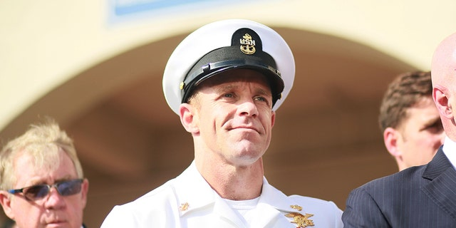 SAN DIEGO, CA - JULY 02:R, Navy Special Operations Chief Edward Gallagher celebrates after being acquitted of premeditated murder at Naval Base San Diego July 2, 2019 in San Diego, California. Gallagher was found not guilty in the killing of a wounded Islamic State captive in Iraq in 2017. He was cleared of all charges but one of posing for photos with the dead body of the captive. (Photo by Sandy Huffaker/Getty Images)