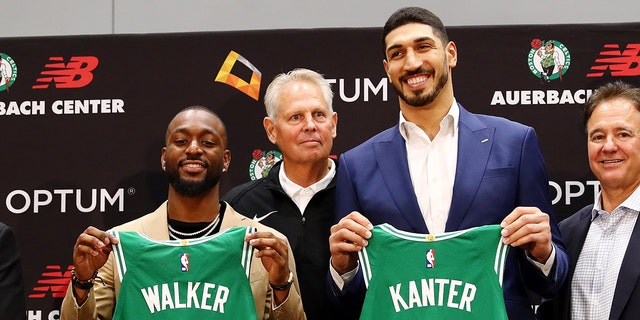 Kemba Walker (L) and Enes Kanter (R) are introduced as members of the Boston Celtics by Celtics President of Basketball Operations Danny Ainge during a press conference at the Auerbach Center at New Balance World Headquarters on July 17, 2019 in Boston, Massachusetts. (Photo by Tim Bradbury/Getty Images)