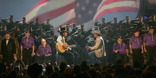 Musicians Big Kenny Alphin (L) and John Rich of Big and Rich perform onstage during the 41st Annual Academy Of Country Music Awards held at the MGM Grand Garden Arena on May 23, 2006, in Las Vegas, Nevada.