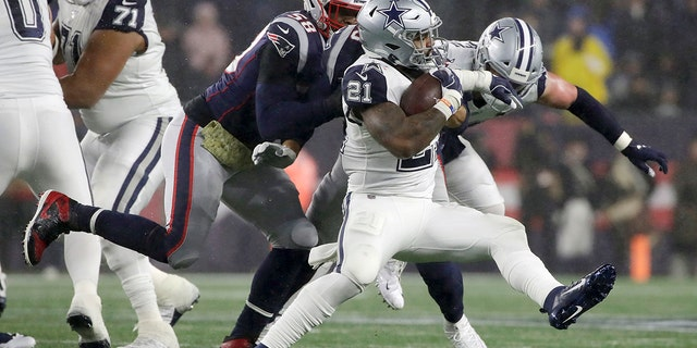 Dallas Cowboys running back Ezekiel Elliott carries the ball as New England Patriots linebacker Jamie Collins, left, gives chase in the first half of an NFL football game, Sunday, Nov. 24, 2019, in Foxborough, Mass. (AP Photo/Elise Amendola)