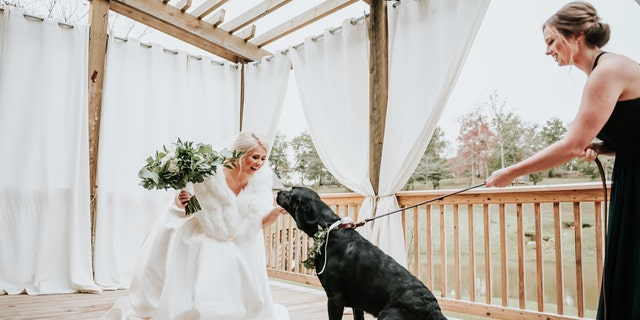 """Duncan decided pretty early on that he wanted to see me for the first time walking down the aisle with my father, rather than a 'first look.' In passing, we joked about me doing one with Zeke,"" bride Kristen Dupree said."
