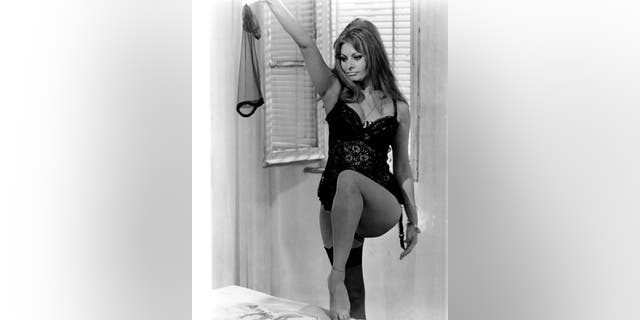 Italian actress Sophia Loren performs a striptease in a scene from the film 'Yesterday, Today and Tomorrow.'