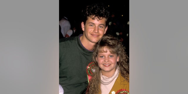 Kirk and Candace Cameron attend the Hollywood Christmas Parade on Nov. 27, 1989, in Hollywood, Calif.