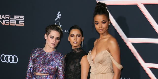 """Kristen Stewart, Naomi Scott and Ella Balinska at the premiere of """"Charlie's Angels."""" (Photo by JEAN-BAPTISTE LACROIX/AFP via Getty Images)"""