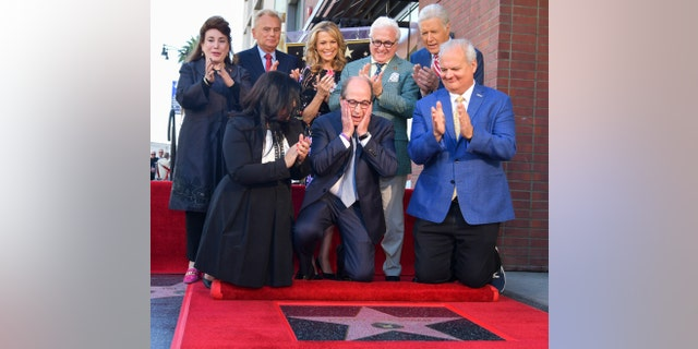 Harry Friedman is honored with a star on The Hollywood Walk of Fame while friends such as Vanna White, Pat Sajak and Alex Trebek watch.