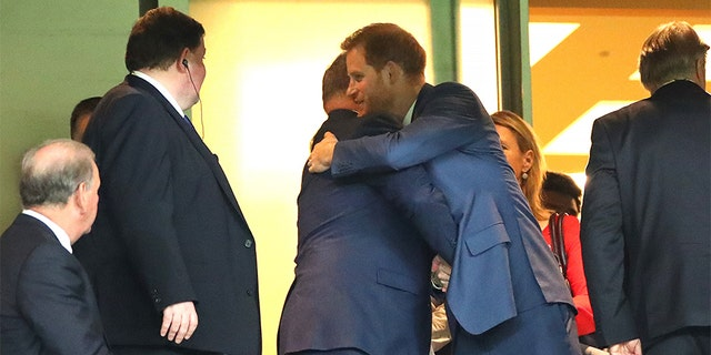Prince Harry, Duke of Sussex (R) embraces Albert II, Prince of Monaco (L) in the stands during the Rugby World Cup 2019 Final between England and South Africa at International Stadium Yokohama on November 02, 2019 in Yokohama, Kanagawa, Japan.
