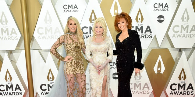 Carrie Underwood, Dolly Parton and Reba McEntire attend the 53rd Annual County Music Association (CMA) Awards. (Photo by John Shearer/WireImage,)