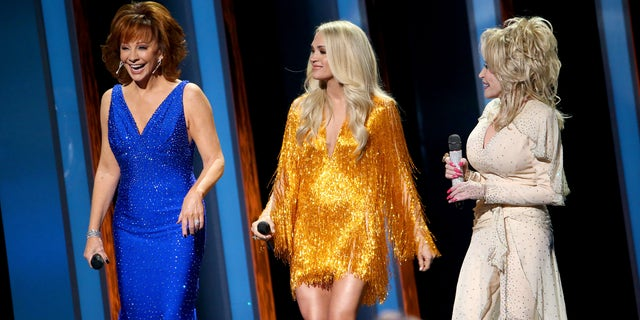 Reba McEntire, Carrie Underwood, and Dolly Parton perform onstage during the 53rd annual CMA Awards at the Music City Center on November 13, 2019 in Nashville, Tennessee. (Photo by Terry Wyatt/Getty Images,)