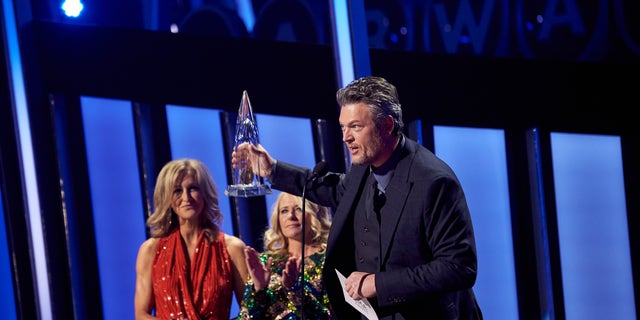 Blake Shelton accepts his CMA Award for Single of the Year. (Photo by John Shearer/Getty Images)